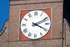 Clock tower. In an Italian village of Roman architecture with red brick stock photography
