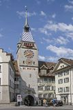 Zyt tower in Zug at the lake. The Clock Tower with its astronomical clock in the capital of the canton Zug at the lake Royalty Free Stock Image