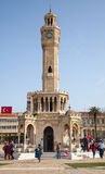 Clock tower of Izmir with ordinary walking people Royalty Free Stock Photos