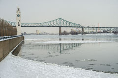 Clock Tower and Jacques Cartier Bridge in Winter Stock Photo
