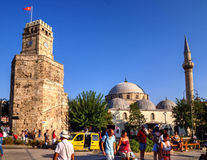 The Clock Tower in Kalekapisi Square and mosque, Antalya, Turkey Royalty Free Stock Images