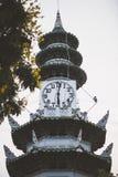 The clock tower at Lumpini Park in Bangkok Royalty Free Stock Photos