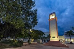 The clock tower on the main square of Cozumel, Mexico. With trees at dusk stock photo