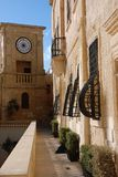 Clock Tower in Malta. An old clock tower near a cathedral in an ancient city in Gozo, Malta Royalty Free Stock Photo