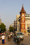 Clock Tower in Mandalay, Myanmar. A typical street in the city of Mandalay in Myanmar in the evening sun. The photo shows the famous clock tower on one of the royalty free stock photo