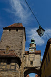 Clock tower and medieval buildings in Rothenburg Stock Photography
