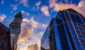 Clock tower and modern buildings at sunset in Boston, Massachuse Stock Photos