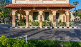 Clock tower in Montaza public park with arches, green wooden window shutters and red tile canopy, Alexandria, Egypt Royalty Free Stock Photography