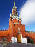 Clock tower of Moscow Kremlin with white clouds Stock Images