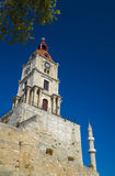 Clock tower and mosque minaret of old Rhodes Royalty Free Stock Photos