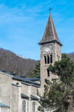 Clock tower at mountains. Tower with clock at France province near to mountains Stock Photos