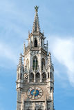 Clock tower of the new town hall building in Munich, Germany Stock Images