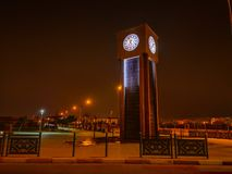 Clock tower. Night view of a clock tower in a public place in the Laayoune city, Morocco royalty free stock photography