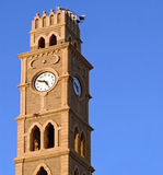 Clock tower in old Akko. With faces in Hebrew and Arabic, crowned with Israeli flag Stock Photography