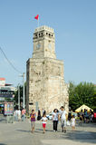 Clock Tower, Old Antalya, Turkey. ANTALYA, TURKEY - AUGUST 18, 2014:  Pedestrians enjoying the summer sunshine by the historic clock tower in the centre of old Royalty Free Stock Photos
