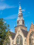 Clock tower of Old church in Amsterdam Royalty Free Stock Photos