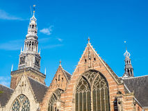 Clock tower of Old church in Amsterdam Stock Images