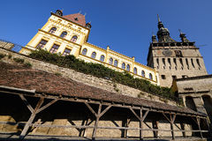 Clock tower on the old city in Sighisoara, Romania Royalty Free Stock Photos