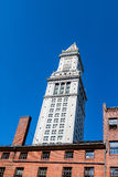 Clock Tower on Old Customs House on Blue Stock Images