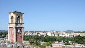 Clock tower at old fortress with old city at background Corfu Greece stock video footage