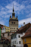 Clock tower and old houses of  medieval town of Sighisoara, Tran Royalty Free Stock Photo