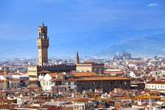 The clock tower of the Old Palace (Palazzo Vecchio) in Signoria Square, Florence Italy Royalty Free Stock Photo