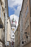 Clock tower of Old Town Hall with flags in Salzburg, Austria, Europe Stock Image