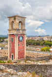 Clock tower at old venetian fortress with old city at background Royalty Free Stock Image