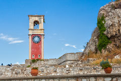 Clock tower at old venetian fortress with old city at background Stock Image
