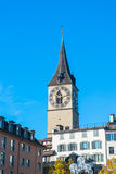 Clock tower over the buildings in Zurich Royalty Free Stock Images
