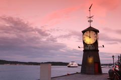 Clock tower on the pier of Oslo Stock Photos