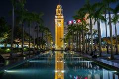 Clock Tower and pool in Hong Kong at dusk Royalty Free Stock Photo