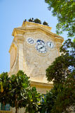 The clock tower in Prince Alfred`s Courtyard of Grandmaster`s Pa Royalty Free Stock Images