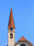 Clock tower of the protestant church in the town of Wallisellen, Stock Image