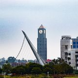 Clock Tower in San Diego. A clock tower and a sculpture grace the San Diego Urban Skyline stock image