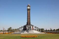 Clock tower in Sharjah. Clock tower at the University of Sharjah, United Arab Emirates Stock Photo