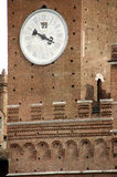 Clock tower Siena. Details of a clock in city hall, Siena, Italy, that tells time and the day of the month Royalty Free Stock Images