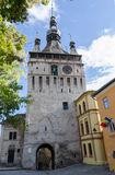 Clock tower in SighiÈ™oara, Romania. Clock tower dating back to 1280 in the fortified citadel of SighiÈ™oara, Romania, one of the most beautiful and royalty free stock photography
