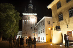 The clock tower of Sighisoara by night Royalty Free Stock Photos