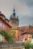 Clock tower-Sighisoara,Romania. Crossed processed image of the Clock Tower from Sighisoara,Romania Stock Photography