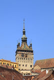 Clock Tower-Sighisoara,Romania. Image of the Clock Tower over the houses roofs in Sighisoara,Romania Stock Photo