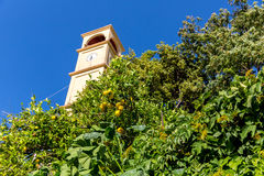 The clock tower in Small cretan village in Crete island, Greece. Building Exterior Stock Photo