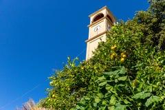 The clock tower in Small cretan village in Crete island, Greece. Building Exterior Stock Photography
