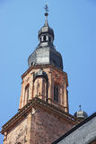 Clock tower and spire of Cathedral of Holy Spirit in Heidelberg Royalty Free Stock Photo