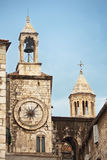 Clock tower in Split. City clock tower, part of Diocletians palace wall, and watch tower which is part of the cathedral of St. Domnius in historical town of Royalty Free Stock Photography