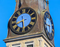 Clock on the tower of the St. Jakob Church in the city of Zurich. Switzerland Royalty Free Stock Photography