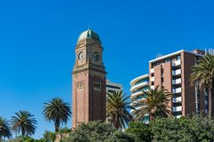 Clock tower in St Kilda suburb of Melbourne. With palm trees on the background Royalty Free Stock Images