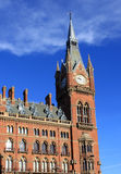 Clock tower St Pancras Renaissance Hotel London. Clock tower that is part of the facade of the St Pancras Renaissance Hotel on Euston Road in London. Behind this Royalty Free Stock Photo