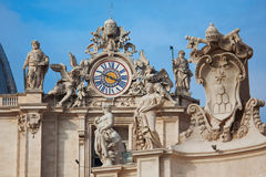 Clock on the tower of St. Peter's Basilica Stock Photo