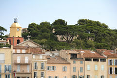 Clock Tower in St Tropez. And ancient buildings in the resort Stock Images